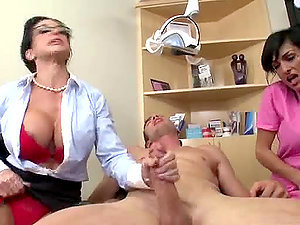 Brown-haired Medic and Nurse Sharing a Patient's Big Man rod in CFNM Threesome